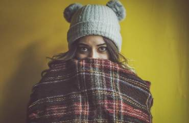 Girl in blanket and hat